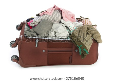 Open suitcase with clothing isolated on white - stock photo