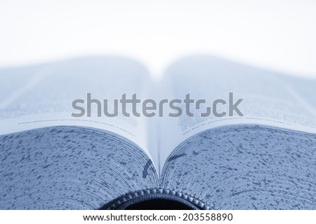 Open textbook with blank top half for type - stock photo