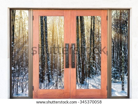 Open the door handle conservatory overlooking the forest and the sun - stock photo