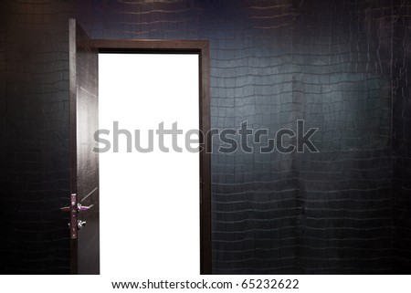 Open the door. Wall, black leatherette wallpaper. - stock photo