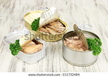 Open tin can, on wooden background - stock photo