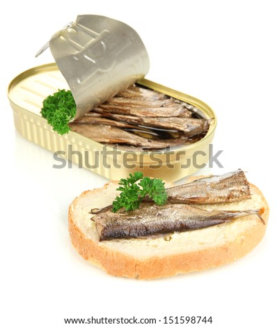 Open tin can with sardines and tasty sandwich, isolated on white - stock photo