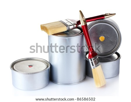 open tin cans with paint and brushes isolated on white - stock photo