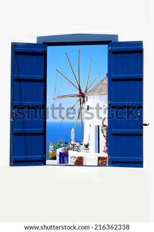 Open traditional Greek blue window on Santorini island, Greece        - stock photo