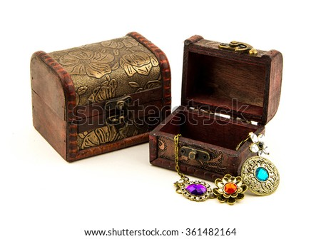 open treasure chest with jewelry isolated on white / Opened redwood carved casket handmade with jewelry isolated on white / casket with gold on a white background