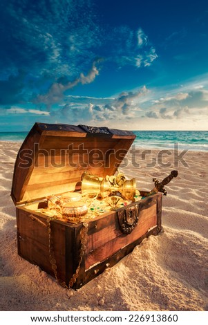 open treasure chest with shinny gold - stock photo