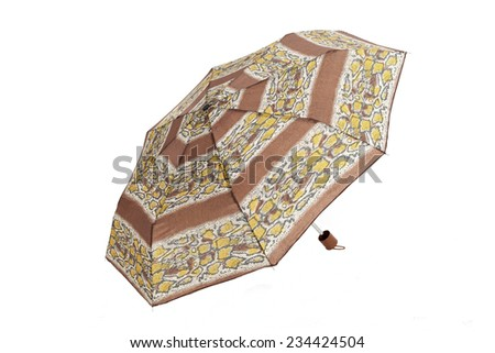 Open  umbrella with abstract brown and yellow elements isolated on white with clipping path - stock photo