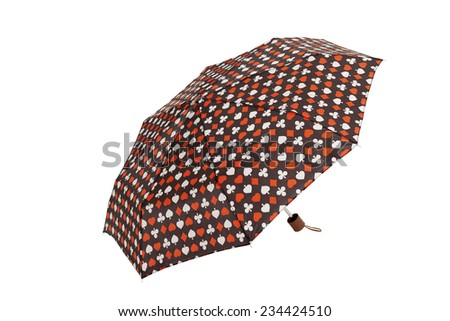 Open  umbrella with playing cards elements isolated on white with clipping path - stock photo