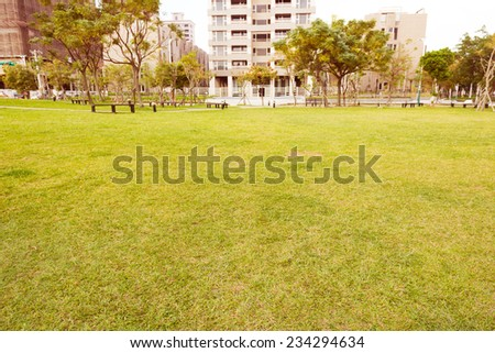Open Urban Green Park Space in front of Residential Buildings