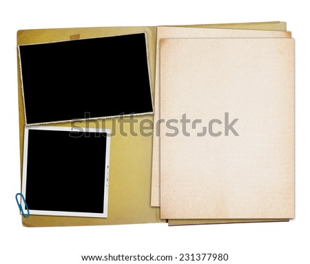 Open vintage folder with two old photographs, isolated, clipping path.