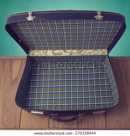Open vintage suitcase. View from above - stock photo