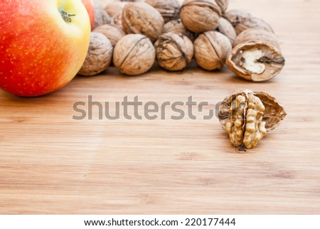 Open walnuts close up on wooden background. Autumn concept - stock photo