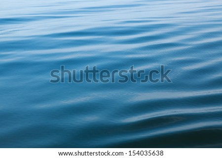 Open Water with ripples on a pond in Maine - stock photo