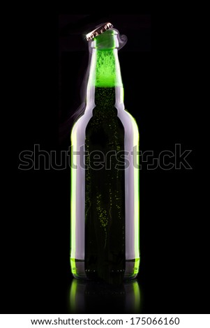 open wet beer bottle isolated on black