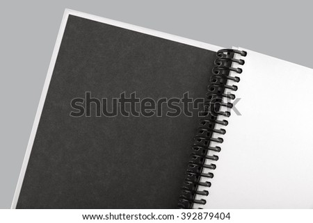 Open white paper notebook close up on the grey background