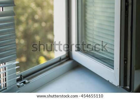 Open white window closeup on nature background. - stock photo