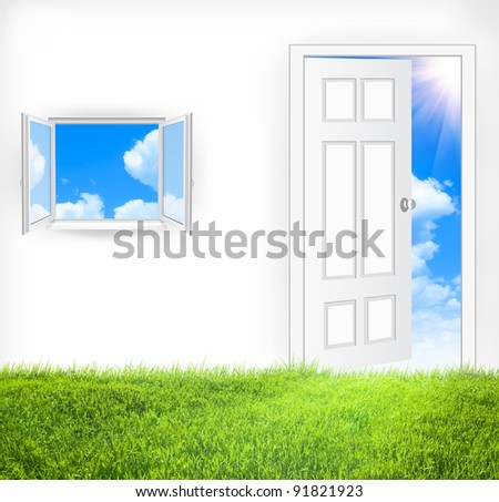 Open window and door in a blue sky. Green grass inside - stock photo