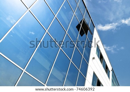 Open window in modern glass wall office building