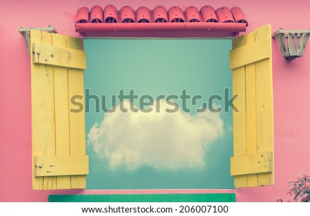 Open window in summer day with cloud on blue sky (vintage color toned image) - stock photo