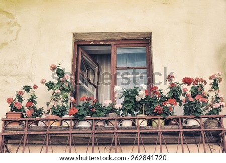 open window, old, with flowers on the windowsill, in the old style photo image.
