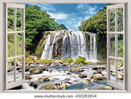 Open window panoramic view to famous huge waterfall on Reunion island - stock photo
