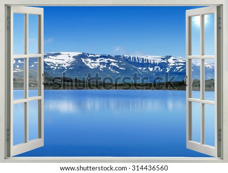 Open window view to mountain lake in Banff national park, Canada - stock photo