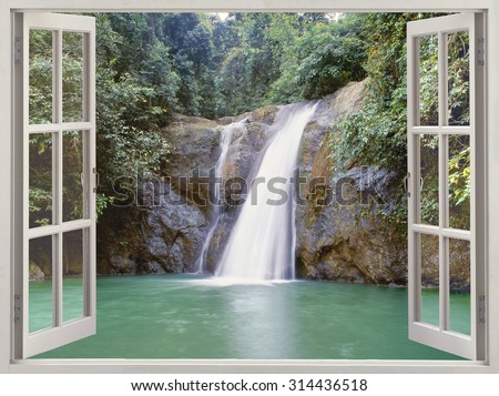 Open window view to tropical waterfall  near the City of Waterfalls, Iligan, Mindanao, Philippines