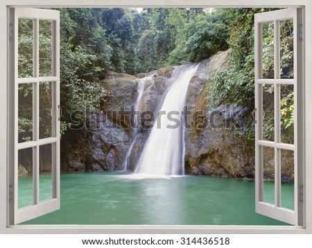 Open window view to tropical waterfall  near the City of Waterfalls, Iligan, Mindanao, Philippines - stock photo