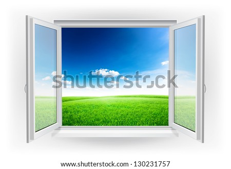 Open window with green field under blue sky on a background