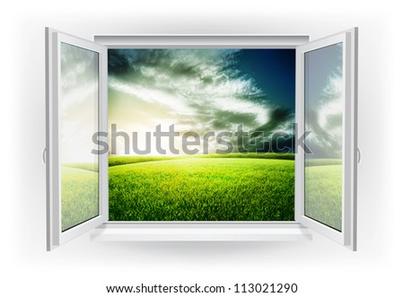 Open window with green field under sunset sky on a background - stock photo