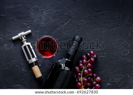 Bottle And Corkscrew On Black Stone Table Background Top View Copyspace