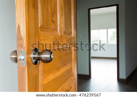 open wooden door empty room in building residential house