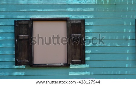 open wooden  window and blue wooden in background