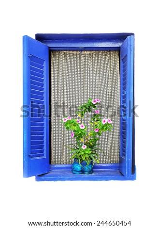 Open wooden window with flower pot.Greece. - stock photo