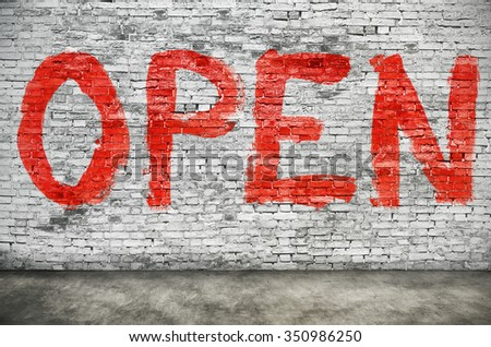Open word painted over white brick wall - stock photo