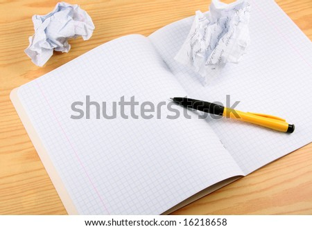 Open writing-book with the pulled out and crumpled draft records. - stock photo