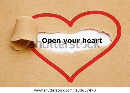 Open your heart, appearing behind torn brown paper. - stock photo