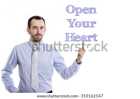 Open Your Heart - Young businessman with small beard pointing up in blue shirt