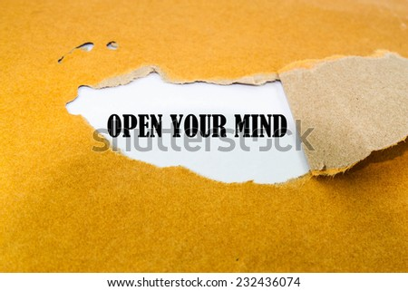 Open your mind concept on brown envelope - stock photo