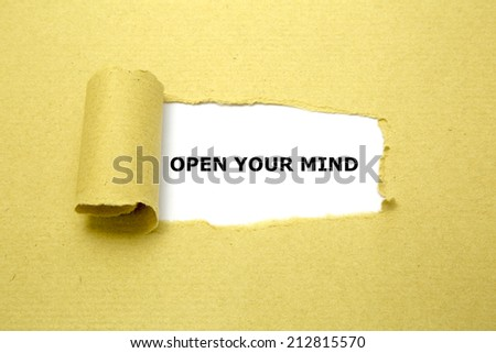 Open Your Mind text appearing behind torn brown paper. - stock photo