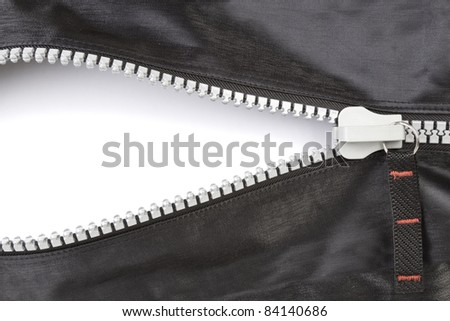 Open zipper with a blank space with a soft shadow. - stock photo