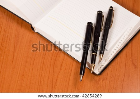 Opened address books with pens - stock photo