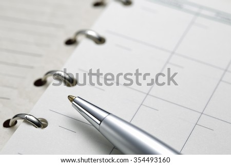 opened agenda ; shot with very shallow depth of field - stock photo