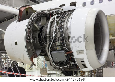 opened aircraft engine repair in the hangar - stock photo