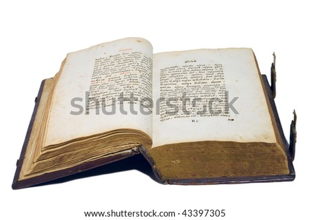 Opened ancient big book isolated over white. With gold fasteners and leather hard cover. Close up - stock photo