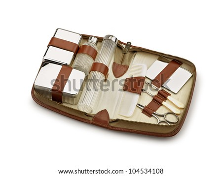 Opened beauty toilet Kit for travel on white background - stock photo