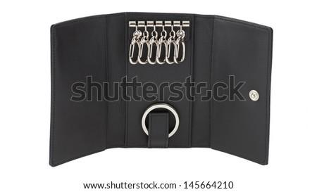 Opened black leather key holder isolated on white background - stock photo