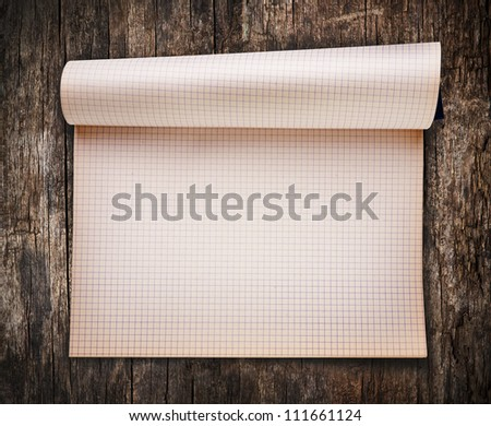 Opened blank notebook on old wood background - stock photo