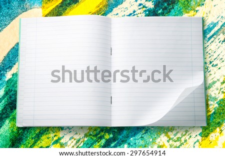 Opened blank notebook with folded left corner - stock photo