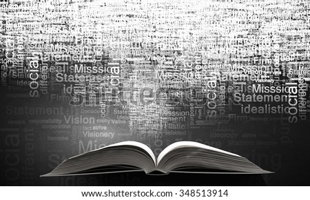 Opened book and business leadership conceptual words - stock photo